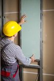 Builder in new building interior Royalty Free Stock Photo