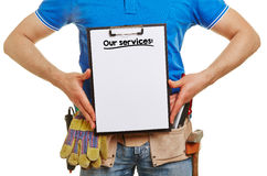 Builder offers our services. On a clipboard Royalty Free Stock Images
