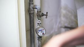 Builder opening water tap to see work of new pipes and correct work of meter stock video