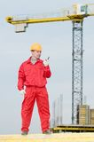 Builder operating the tower crane Royalty Free Stock Photography