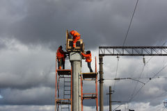 Builder in orange working on concrete piles Stock Photos