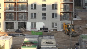 Builder paint house facade white with roller. 4K stock video