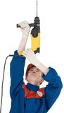 Builder and perforator. Man in worker cloth and yellow perforator Stock Images
