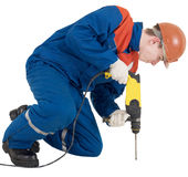 Builder and perforator. Builder holding yellow perforator on the hands Stock Images