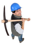 Builder with a pickaxe Stock Photo