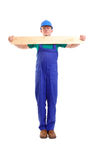 Builder with plank Stock Image