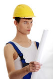 Builder with plans Stock Image
