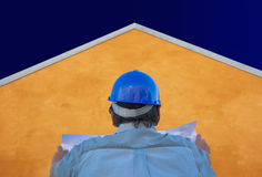 Builder, plans, orange house and sky Stock Photography