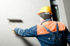 Builder plastering facade wall Royalty Free Stock Photo