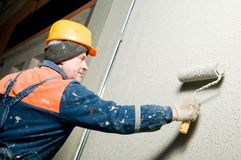Builder plastering facade wall Stock Photography