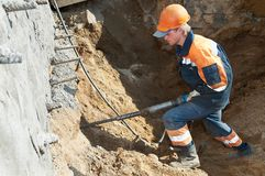 Builder with plugger Stock Photo