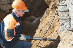 Builder with plugger Royalty Free Stock Photo
