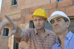 Builder pointing into distance Royalty Free Stock Image