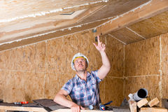 Builder Pointing Up at Ceiling in Unfinished Home Stock Photography