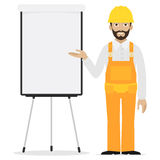 Builder points to flipchart Stock Photo