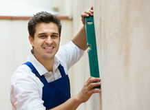 Builder posing with spirit level Stock Image