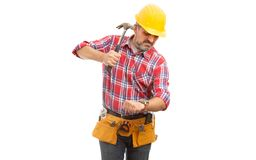 Builder preparing to destroy wristwatch with hammer. Angry builder preparing to destroy wristwatch with hammer as time concept isolated on white studio royalty free stock photos