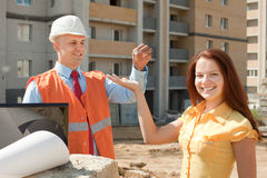 Builder presents the keys to girl Stock Image
