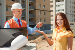 Builder presents the keys to girl Stock Photos
