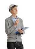Builder in a protective helmet and with a clipboard Stock Photo