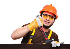 Builder pulls a nail Royalty Free Stock Photography