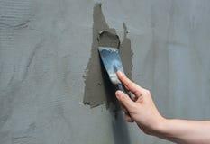 Builder puts mortar trowel wall. Plaster walls. Stock Image