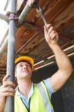Builder Putting Up Scaffolding Stock Photos