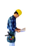 Builder Reading Blueprints Stock Photo