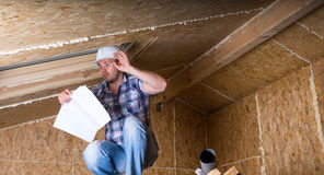 Builder Reading Plans Inside Unfinished Home Royalty Free Stock Photos