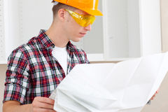 Builder with repair plan Royalty Free Stock Photo