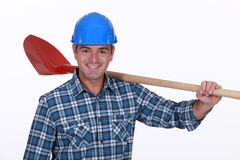 Builder resting shovel on shoulder Royalty Free Stock Photography