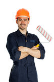 Builder with roller for painting isolated on white background. Young worker standing with roller for painting isolated on white background Royalty Free Stock Photography