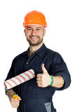 Builder with roller for painting isolated on white background. Young worker standing with roller for painting isolated on white background Royalty Free Stock Images