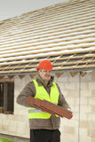 Builder with roof tiles Stock Photography