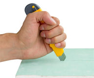 Builder's hand with knife Stock Image