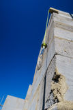 Builder's plumb line hanging against exterior corner wall of house Royalty Free Stock Image