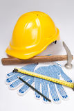 Builder's tools - helmet, work gloves, hammer, pen and measure t Royalty Free Stock Images