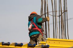 Worker with safety belt and helmet at the  reconstruction area Royalty Free Stock Photo