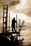 Builder on scaffold building site stock photography