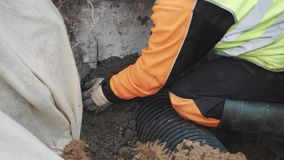 Builder seal stitch ribbed plastic pipe and concrete hole with cement stock footage