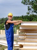 Builder selecting an insulated wall panel Stock Images