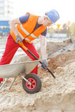 Builder with shovel and barrow Royalty Free Stock Photos