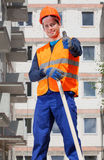 Builder showing thumbs up sign Royalty Free Stock Image