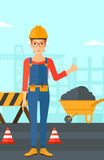 Builder showing thumbs up. A woman in helmet showing thumbs up sign on a background of construction site with road barriers and wheelbarrow vector flat design Royalty Free Stock Images