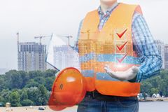 Builder shows a list of completed works. royalty free stock images