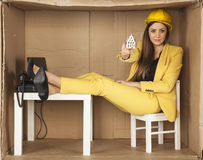 Builder shows a prototype of a new home for you. Builder shows a prototype, of a new home for you Stock Photography