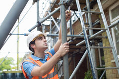 Builder On Site Putting Up Scaffolding Stock Images