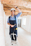 Builder smiling and holding hammer Royalty Free Stock Photos