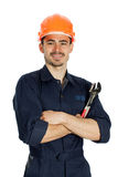 Builder with spanner isolated on white background. Young worker standing with spanner isolated on white background Royalty Free Stock Photos