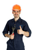 Builder with spanner isolated on white background. Young worker standing with spanner isolated on white background Stock Photo